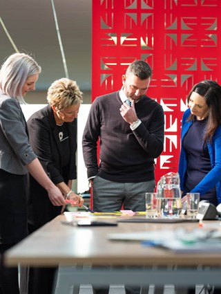 photo of people standing and working together